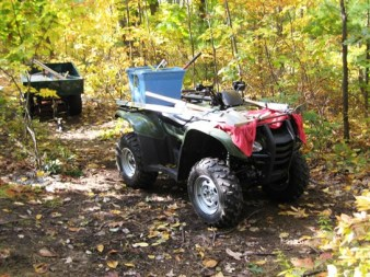 Blake's ATV with tubs used to hold Quikrete and supplies