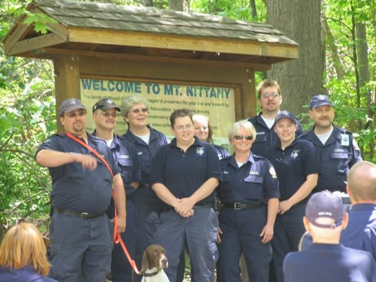 CREST at the Grand Reopening Ribbon Cutting. Certified search and rescue personnel from CREST: From L to R – Eric Prescott and K-9 Shasta, Dr. Clifford Neal, DO, Rosemarie Stover, Tracy Reagan, Nikki Hamilton, Kathleen Neal, Jennifer Williams, Mark Milliron