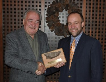 MNC President Vince Verbeke presents Willy with his own piece of the Mountain below. Left-right: Willy Kogelmann, 2010 Friend of the Mountain Awardee; Vince Verbeke MNC President.